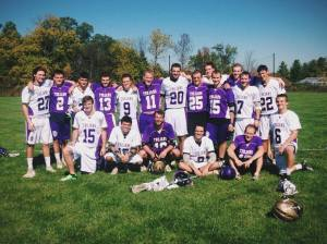 Picture of the team and the alumni after their game .